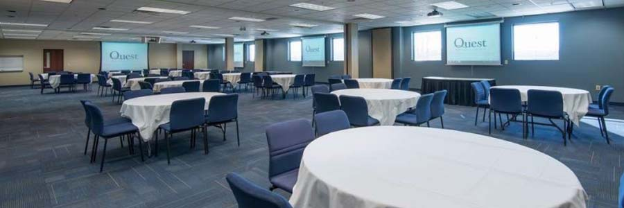 an example of a large sized meeting room set up with round tables at Quest conference center